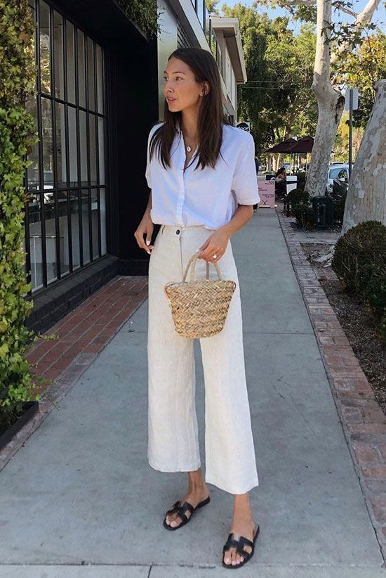 25 Ultra-Fresh Summer Looks To Wear To Work: Fashion blogger @fakerstrom wearing a white short sleeve shirt, beige linen culottes, black sandals and a straw bag. Work outfits, wear to work, summer work outfits, office looks, office wear, summer outfits, street style, fashion trends 2018, summer style, office style, #weartowork #officestyle #streetstyle #summerstyle #fashion2018 #fashiontrends2018 #9to5chic #bossbabe #ss18