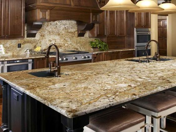 The dark brown in these counters really go nicely with the darker accents in this particular slab. Also, the black of the island creates a great accent piece on its own.