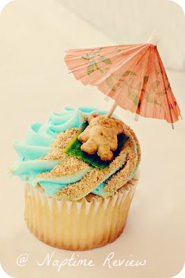 Vanilla cupcake with blue frosting for sea. Put teddy gram crumbs for sand then take a fruit roll up for towel. Final touch, umbrella!: