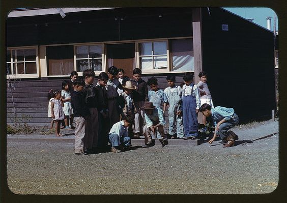 Boys playing marbles, Farm Security Administration labor camp, Robstown, Texas, January 1942.