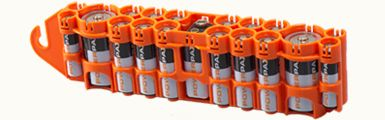 Storacell by Powerpax.  Store you loose batteries in reusable, compact dispensers.  Take them with you on trips or organize batteries at home for toys, electronics and flashlights.