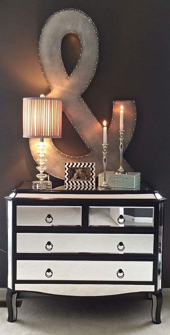 Go big! Oversized accessories or art make a fun impact! Love this large ampersand in our master bedroom. Looks great over our mirrored chest. Both from Home Goods! {Sponsored}