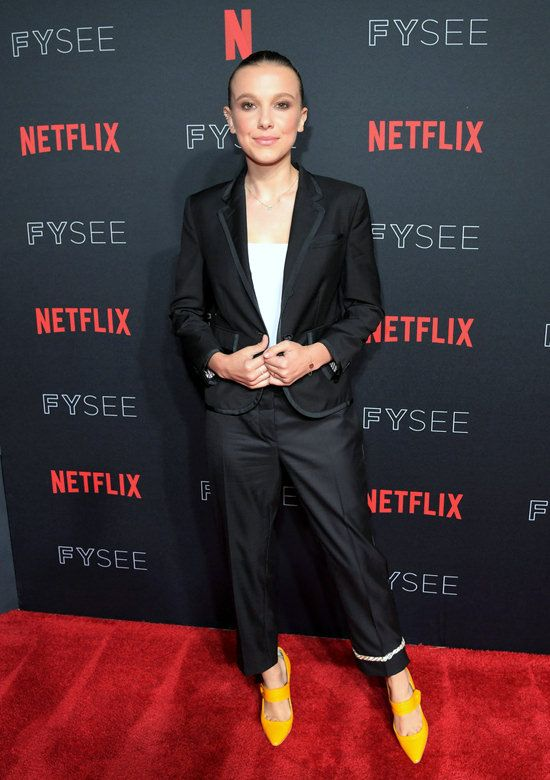 "Millie Bobby Brown in Thom Browne Suit and Moschino Shoes at Netflix's FYSEE Event For ""Stranger Things"""