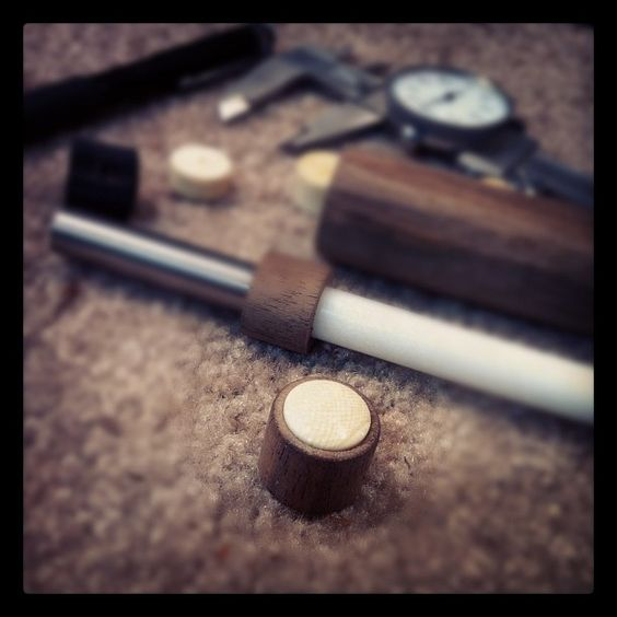 making walnut electric guitar knobs with elephant tusk caps.