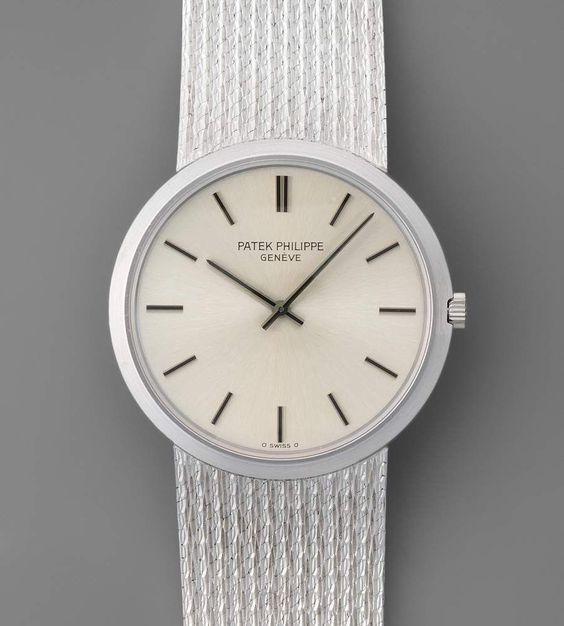 Patek Philippe Runde, automatische Herrenarmbanduhr in 750 Weissgoldgehäuse mit Armband ca. 80 g. — Taschen- und Armbanduhren