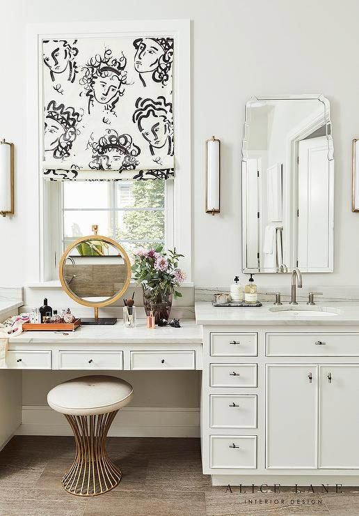 Window Above A Drop Down Makeup Vanity In A Bathroom Featuring A
