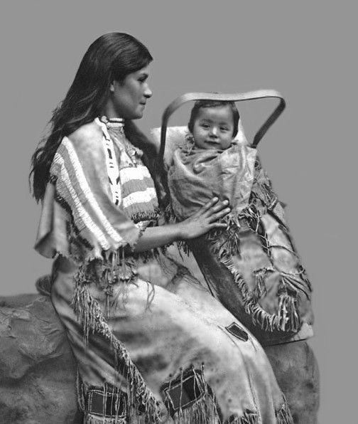 Beautiful Chippewa Woman with infant. Photo taken 1900.