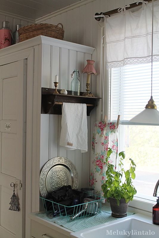 farmhouse kitchen with white cupboard and simple white valance