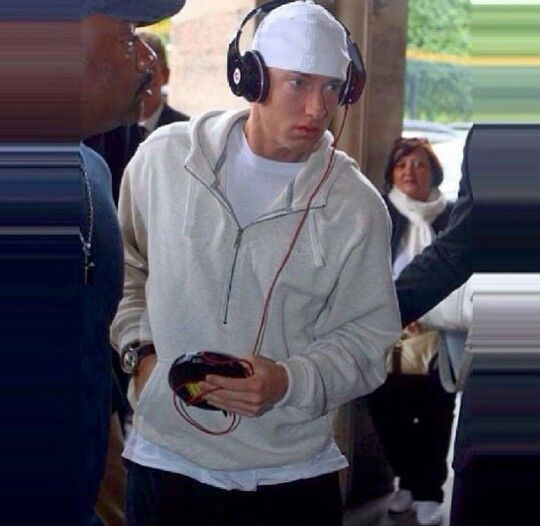 Eminem thuging it with beats and a CD player.