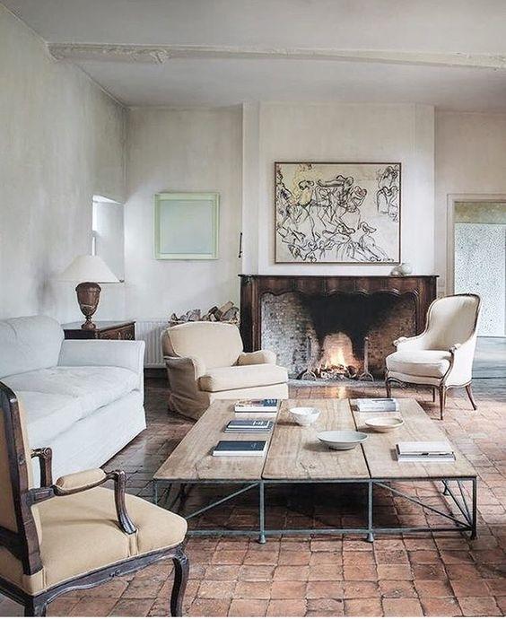 Luxurious elegant living room by #AxelVervoordt with #plasterwalls, terracotta floor, and #minimaldecor