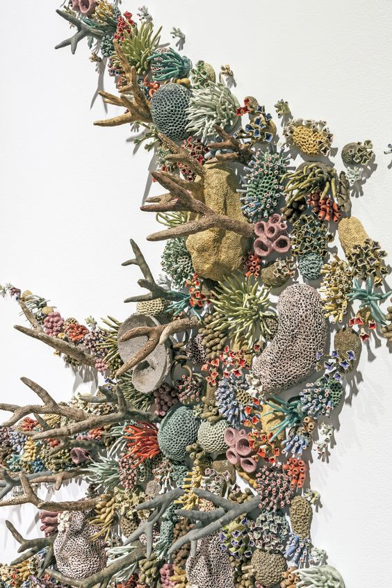 """Doubling as an artist and ocean advocate,Courtney Mattison (previously) produces large-scale ceramic installations that draw attention to conservation of our planet's seas. Her latest installation """"Aqueduct"""" showcases hundreds of porcelain sea creatures including anemones, sp"""