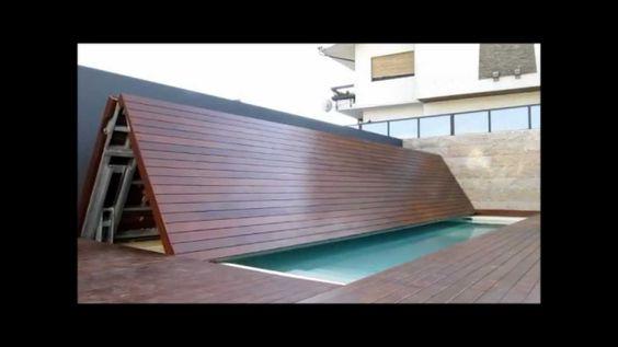 Piscina oculta la cubierta se pliega y se queda recogida Como hacer un cubre piscinas