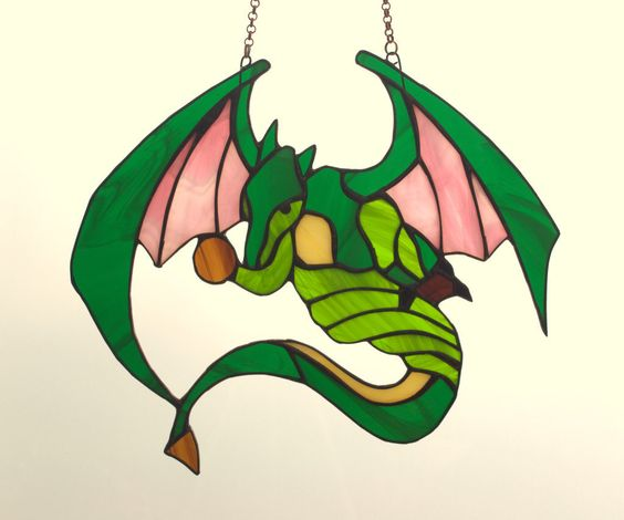 Stained Glass Dragon - tiffany glass dragon. Stained glass suncatcher. by AmberGlassArt on Etsy https://www.etsy.com/listing/239226689/stained-glass-dragon-tiffany-glass