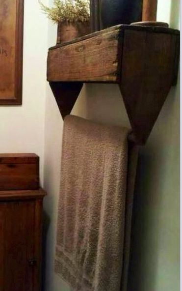 An old wooden tool box makes an adorable towel holder in the bathroom.
