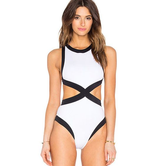 This classic black and white monokini takes the cake is a honeymoon swimsuit staple. You really can't go wrong with its simple color palette and design that's sure to flatter any body type. | OYE Swimwear Kerry One Piece via @revolveclothing