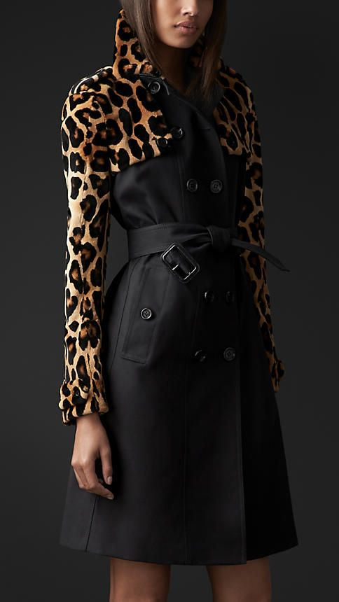 A classic trench coat embellished with soft sheared mink. The fitted gabardine body is overlaid with animal print mink sleeves, gun flaps, collar and rain shield, referencing early designs from the Burberry Heritage Archive.