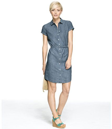 <p>Our classic shirtdress silhouette proves effortless any day of the week, dressed up with heels to the office or worn with sandals on the weekend. Crafted in lightweight indigo chambray, we've taken an iconic workwear fabric and given it a fresh feminine outlook with perfect tailoring and flattering flow. Cuffed short sleeves, full button front. Shirttail hem. Includes self-fabric buckle belt. Unlined. 100% cotton. Imported. Machine wash and dry.</p> <p><b>Signature Fit</b> ...