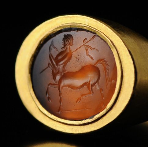 1st century BC to 1st century AD carnelian Roman intaglio set in a modern gold setting.: