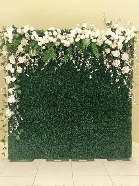 Wedding Photo Backdrop With Artificial Grass Greenery And Flowers Mason Jars With Flameless Candles Diy Backdrop Photo Backdrop Wedding Diy Photo Backdrop