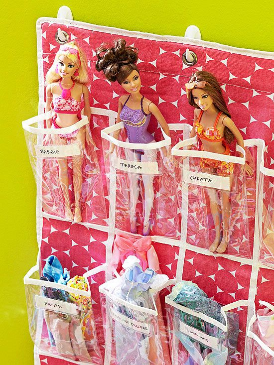 BHG In Kid's Rooms -Simple Toy Storage  Pockets on over-the-door shoe organizers are just the right size for storing small toys. Label each pocket for specific dolls or action figures and for accessories.: