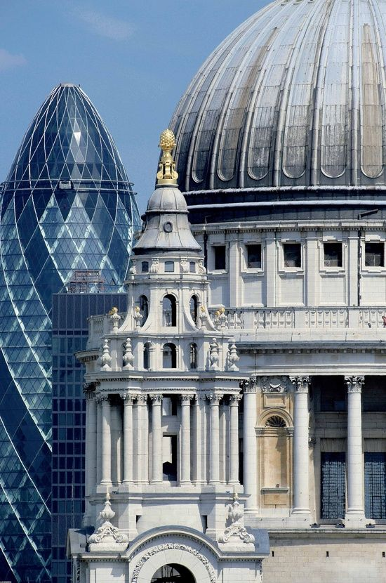 The old meets the new. St Pauls Cathedral and The Gherkin - London (This isnt photoshopped - the City of London and the buildings of the financial district now tower over St Pauls):