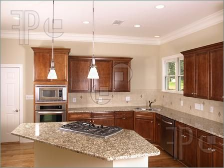 ... with cooktop Picture of Luxury Kitchen corner with island stove