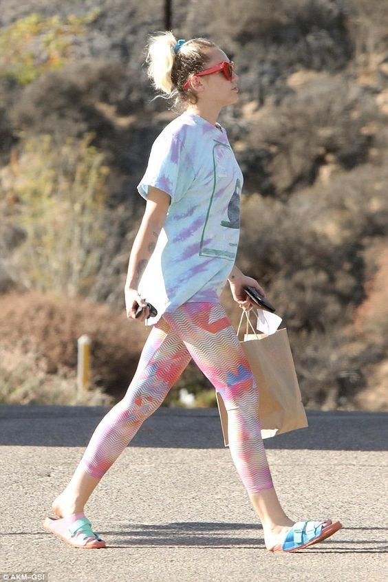 Catty: Completing the former Disney star's attire was a tie dye shirt and crazy cat eye sunglasses