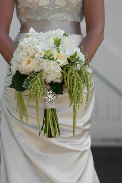 white bouquet with greenery and brooch.