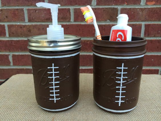 Football bathroom set football painted mason jar for Sports themed bathroom decor