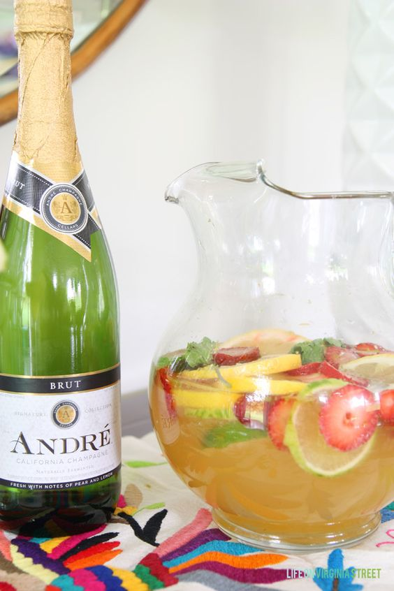 Champagne Sangria Recipe - SO delicious and great for parties! via Life On Virginia Street. Content for 21+ #ad #EpicWithAndre