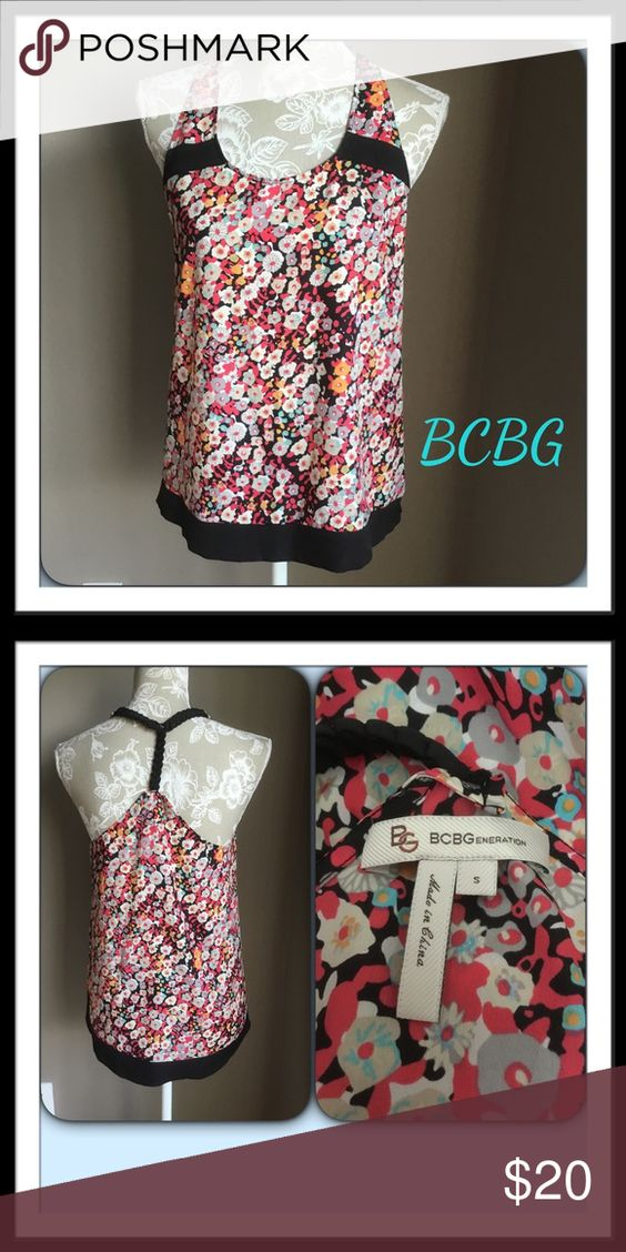 #351  🌴 BCBGeneration TOP LIKE NEW!  Sleeveless top with razor back. Multi colored flowered print. Polyester. BCBGeneration Tops