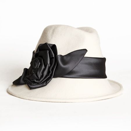 Domino Flower Applique Cloche Hat 59.99 at shopruche.com. This wool hat mixes fedora and cloche hat aesthetics for a gorgeous statement. Crafted in ivory, it is accented with a black satin sash and floral applique for contrast.  100% Wool  Crown: 25