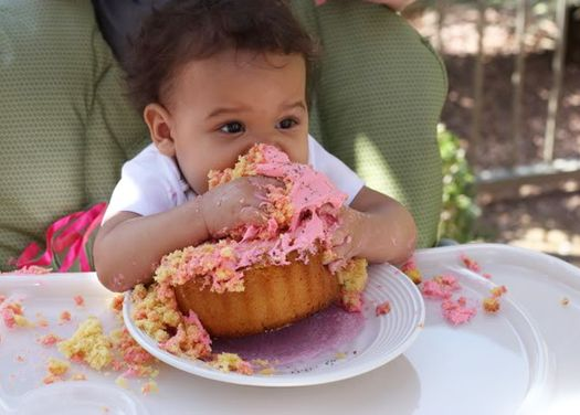Eating a birthday cupcake!  :)