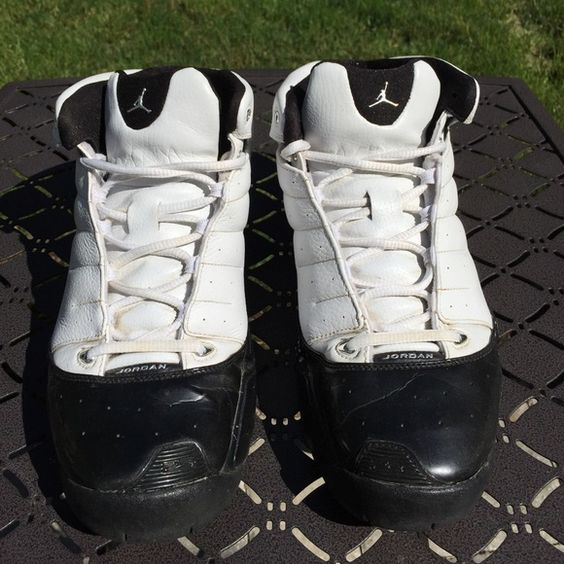 Michael Jordan Men's Sneakers Black and white Michael Jordan mens sneakers. There are some creases in the front of the shoe. These shoes have been worn but have a lot of life left in them. Michael Jordan Shoes Sneakers