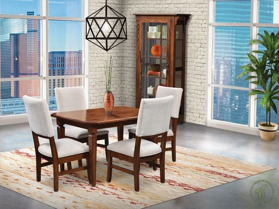 Shown in Oak with a sleek modern upholstery, our Joel Dining Set works for gatherings both small and large with optional hardwood extension leaves.