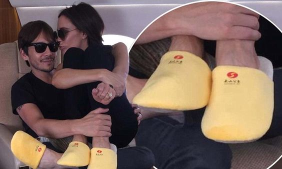 Victoria Beckham swaps her trademark killer heels for comfy slippers