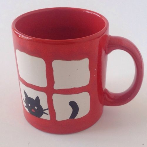 Red And White Coffee Mugs The Table