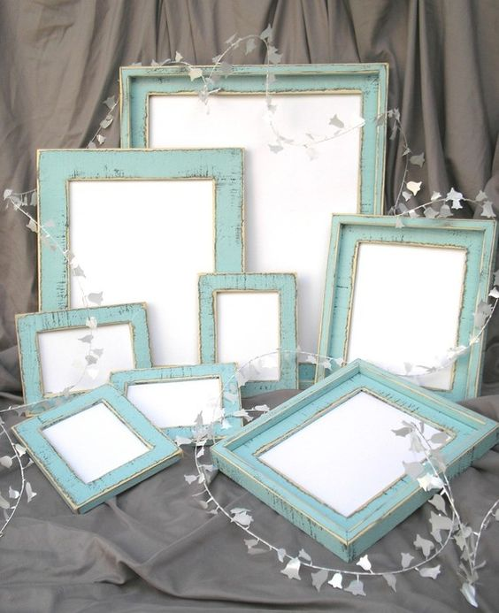 Blue distressed photo frames. i would love to accent one room with a bunch of these!