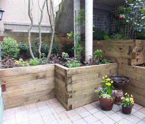 wood planters retaining walls and railroad ties on
