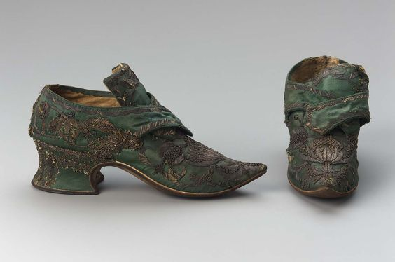 1730s, Europe - Pair of women's buckle shoes - Silk satin embroidered with metallic thread, silk and metallic braid applique, silk satin binding tape, leather, silk and linen lining, and leather soles
