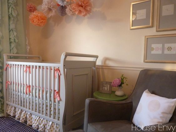 We love the feminine touch to this coral, mint and navy nursery! #nursery #babyroom
