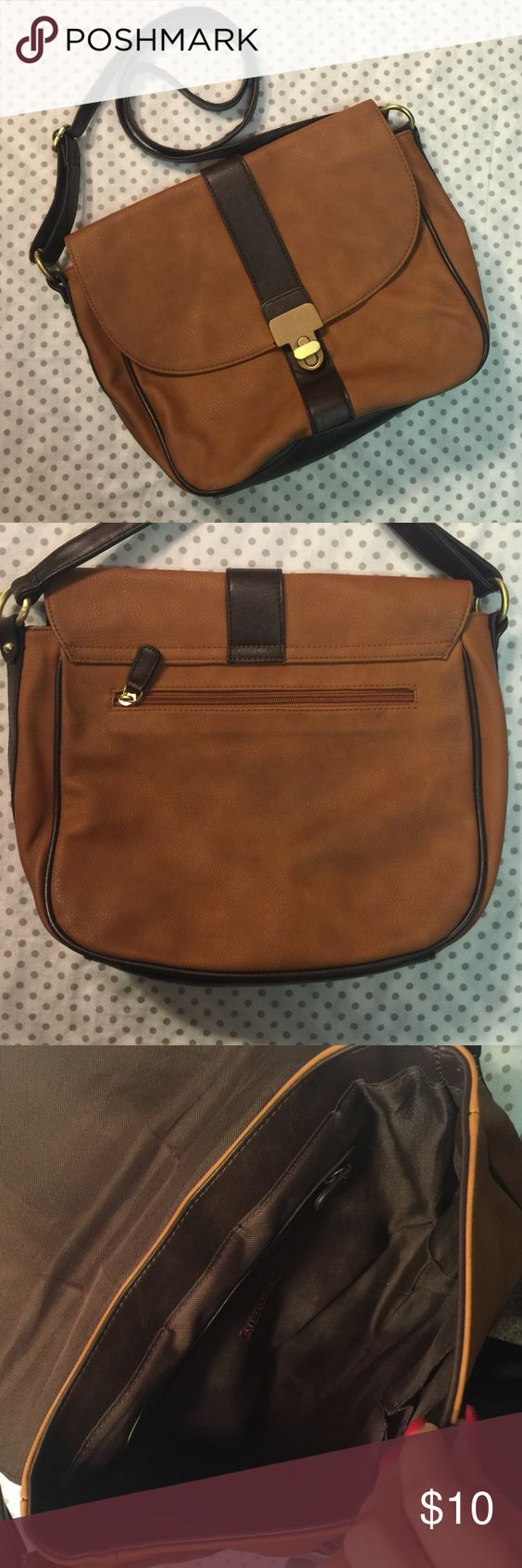 Brown crossbody purse. Adjustable brown crossbody purse with zipper inside and two cell phone style holders.  Zipped on back side of purse as well.  Great condition. Bags