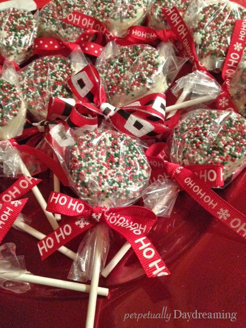 Christmas-y Chocolate Covered Oreo Pops - not sure on cake, dipped in white chocolate and rolled in NPs