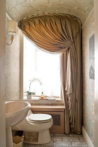 This is an amazing idea for re-doing my downstairs powder room.  I would never have thought of using wallpaper on the ceiling!