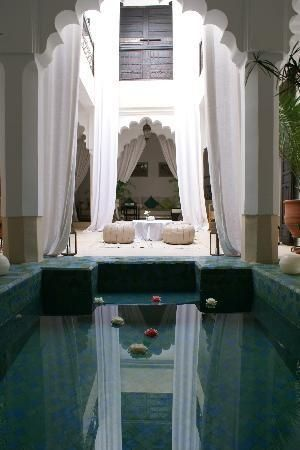 View across the pool and courtyard in Riad Jahan: