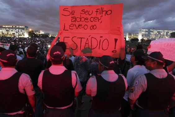 «If your son is ill, take him to the stadium» is written on a board. Brazil is facing huge popular rise against the world cup budget. People say they would rather have public transports, health care and education than stadiums. São Paulo, Brasil (Reuters/Ueslei Marcelino)