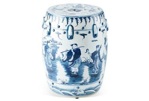 Embellished with a traditional Covert Eight Immortals motif, this handmade, hand-painted garden stool is a sculpture, a functional perch, and a decorative presence in vibrant white-and-blue high-fire porcelain.