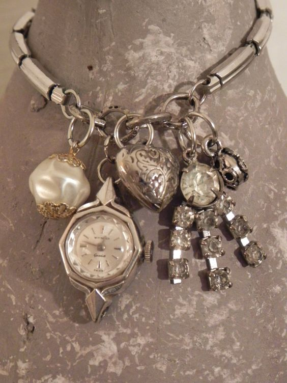 """Vintage Upcycled Repurposed  Watchband Charm Bracelet """"Heart's Content"""". $48.00, via Etsy."""