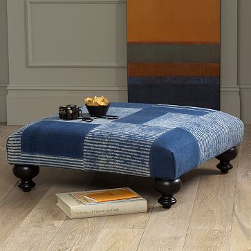 one-of-a-kind ottomans made from antique rugs, love the turned legs....would be even better with pewter castors on them