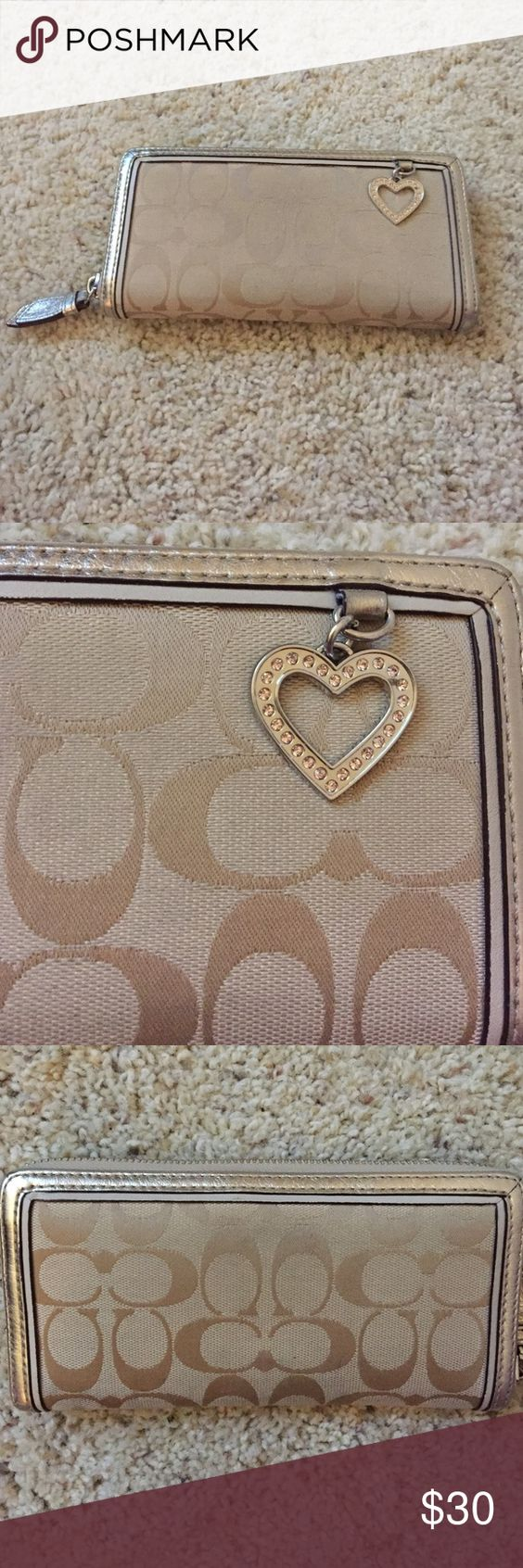 Coach wallet Super cute Coach wallet with heart charm! In good condition. Could use a cleaning but it does not have any tears or stains that wouldn't come out. Coach Bags Wallets